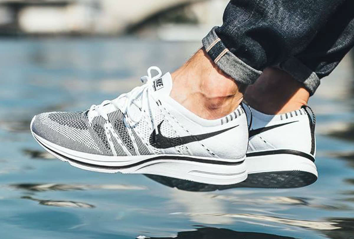 white black nike flyknit trainer on feet
